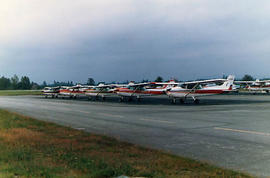 A row of airplanes parked at the Langley Airport