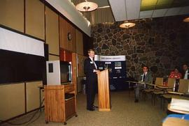 Don Page speaking at a reception