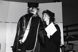 Deane Downey persenting a degree