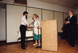 Mrs. Donna Denny presenting an award to Dale Theissen
