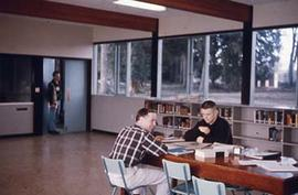 Students studying in the Vernon Strombeck Library.