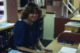 Library staff member working at the circulation desk in the Vernon Strombeck Library.
