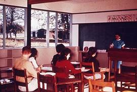 Unidentified female faculty member teaching a class.