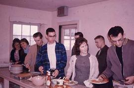 Students gathering in the original lunch room in Seal Kap.