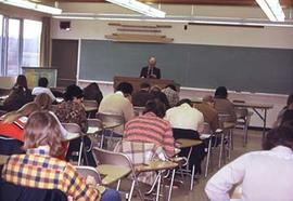 An unidentified faculty member teaches a class.